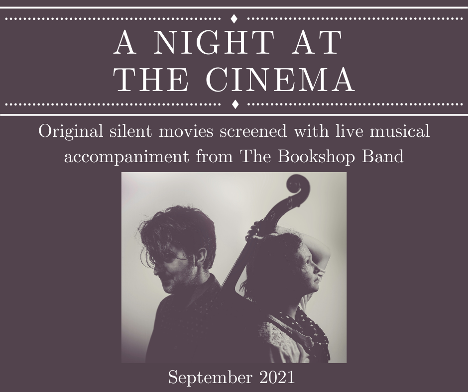 A dark grey square poster with text and an image of 2 people. In the top quarter of the poster, large capitalised text at the top reads 'A NIGHT AT THE CINEMA' with decorative beaded lines above and below, reminiscent of vintage poster. Below, smaller text reads 'Original silent movies screened with live musical accompaniment from The Bookshop Band'. The bottom half of the poster shows a centred square black and white photo of white couple in their thirties, seen from chest up. They stand back to back. The man on the left looks down, the woman on the right looks up and holds a cello by the neck over her left shoulder. Beneath the image, text reads 'September 2021'.